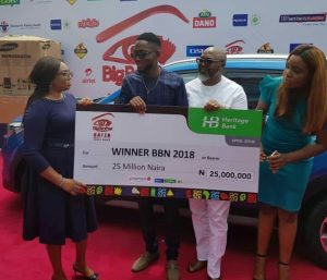 Miracle receiving his N25million cheque